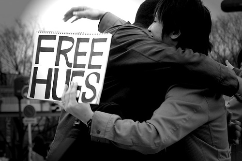 black and white photo two people hugging