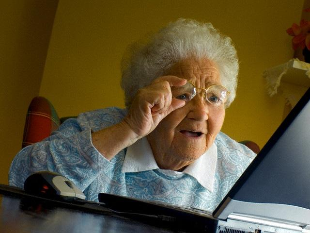 old woman surprised by computer