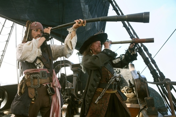 movie pirates Jack Sparrow and Barbossa holding telescopes