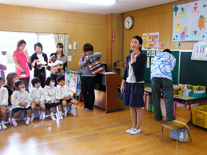 A Japanese teacher addressing her young students