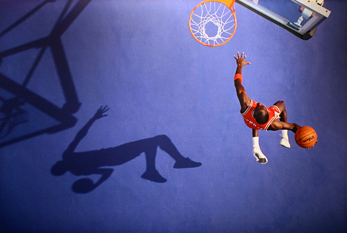 Michael Jordan soaring towards a hoop
