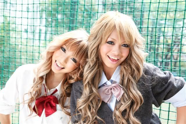 A couple of kogyaru smiling for a photo