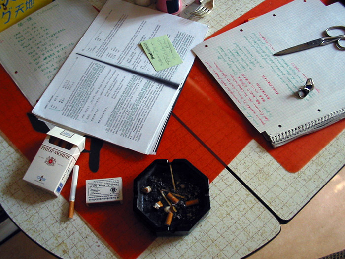 book notepad and ashtray on desk
