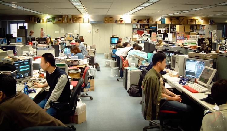 Japanese office workers at their desks