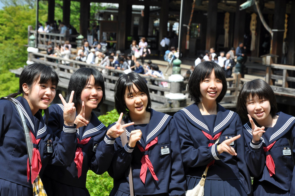 japanese schoolgirls posing for a picture