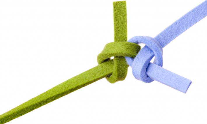 green and blue strands tied in knot