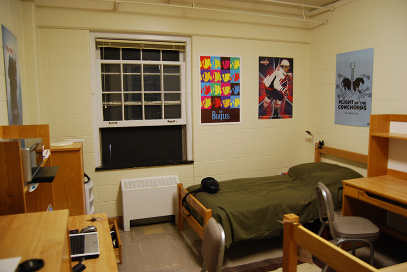 dorm room with posters