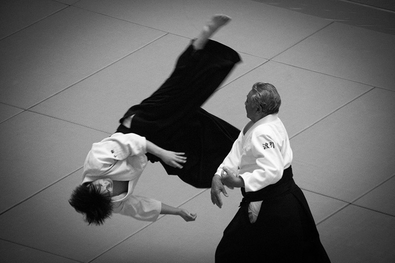 two men sparring with aikido