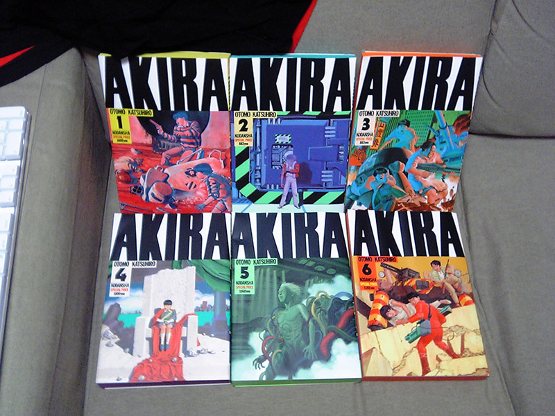 akira book covers arranged on grey couch