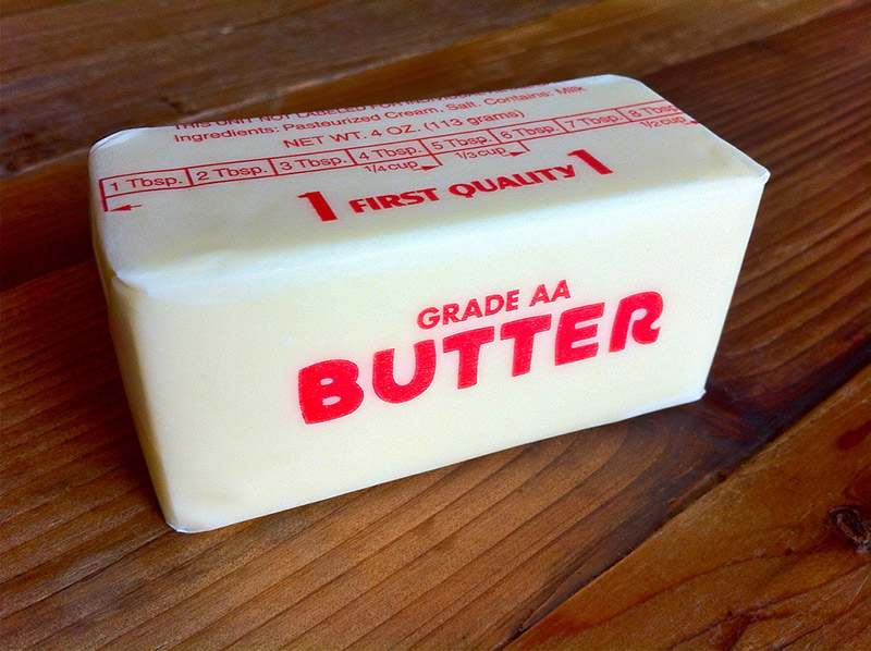 stick of butter in wax paper