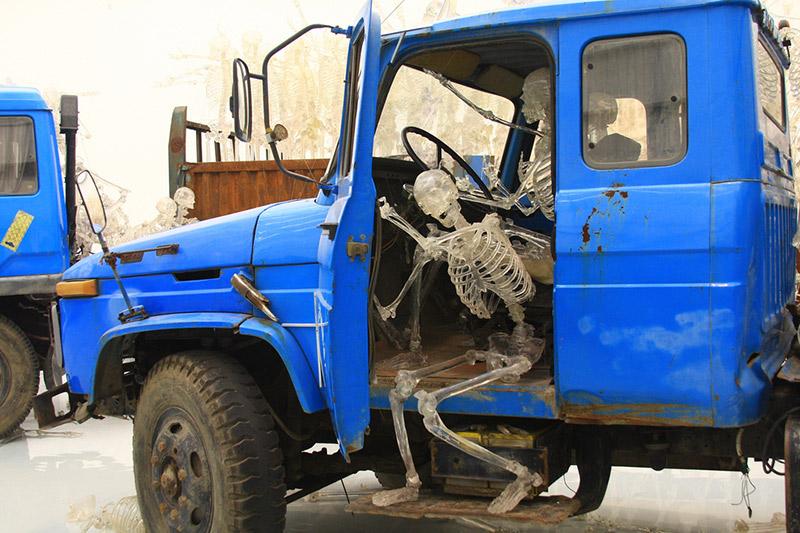 plastic skeletons inside truck cab