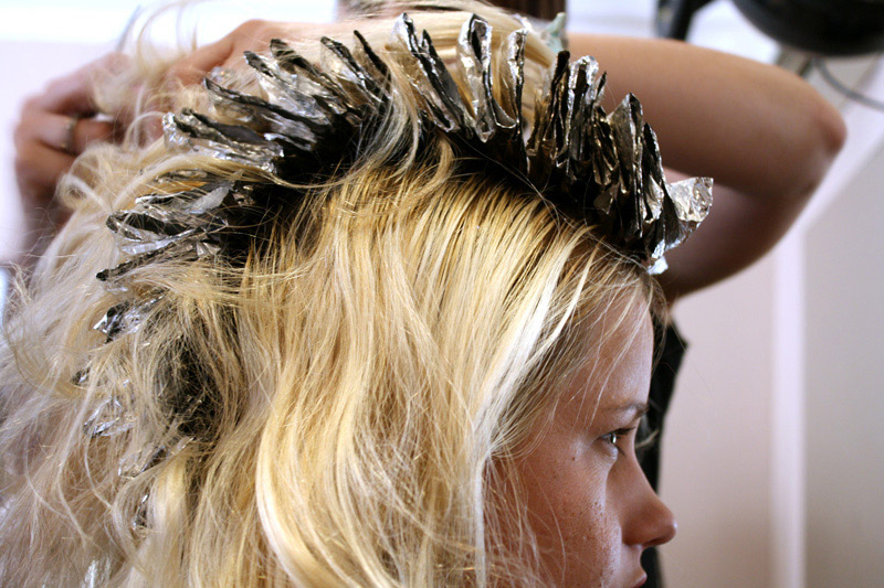 woman getting her hair dyed
