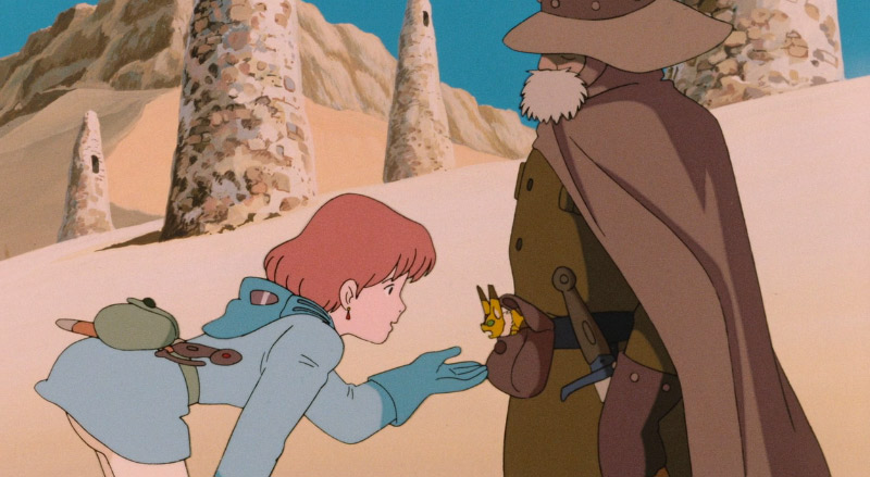 Nausicaa holding her hand out to a small animal