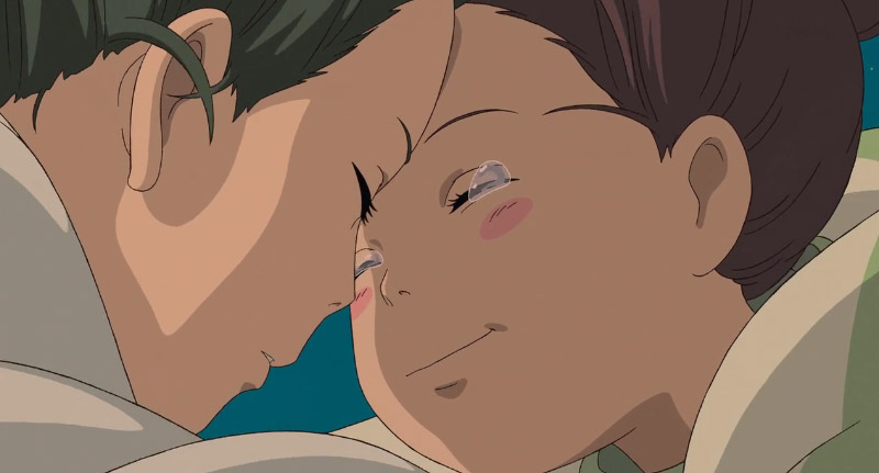 Screenshot of Chihiro and Haku embracing in Spirited Away