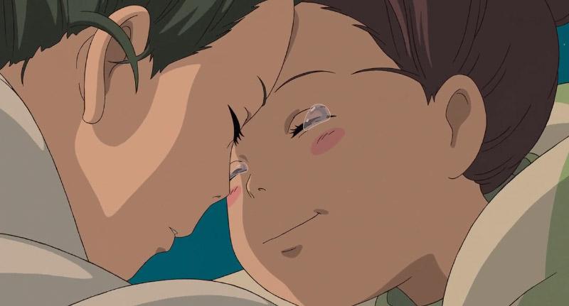 Screenshot of Chihiro and Haku embracing in Spirited Away