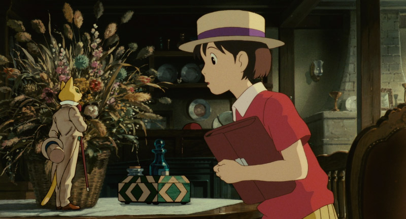 Girl looking at a cat statue in Whisper of the Heart