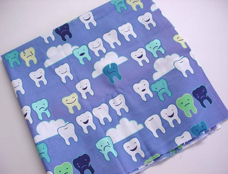 cute cloth with smiling teeth on it