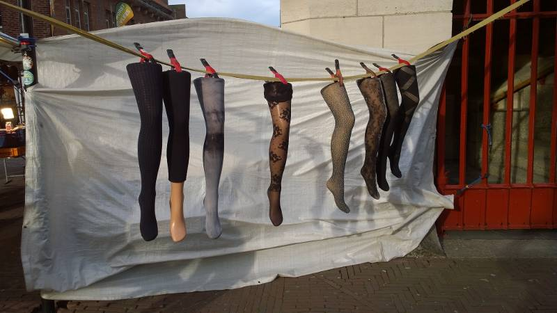 mannequin legs hung from clothesline