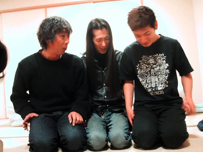 three japanese men sitting in seiza