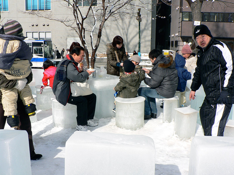 Japanese family sitting on ice stools