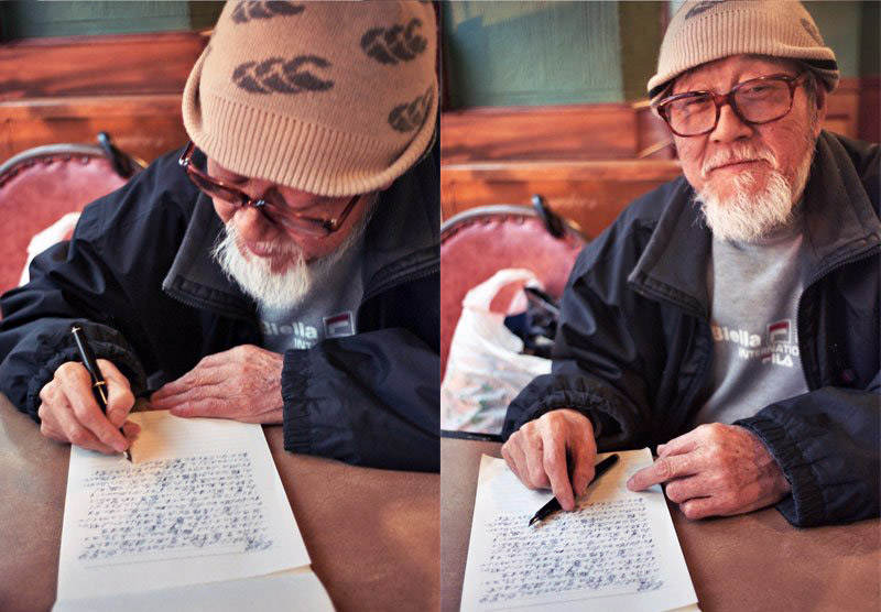 old Japanese man writing on paper