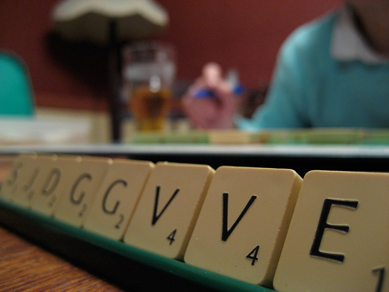 scrabble holder with letter tiles