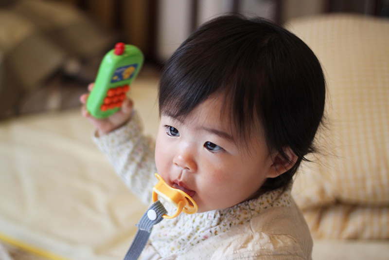 Baby holding a toy phone