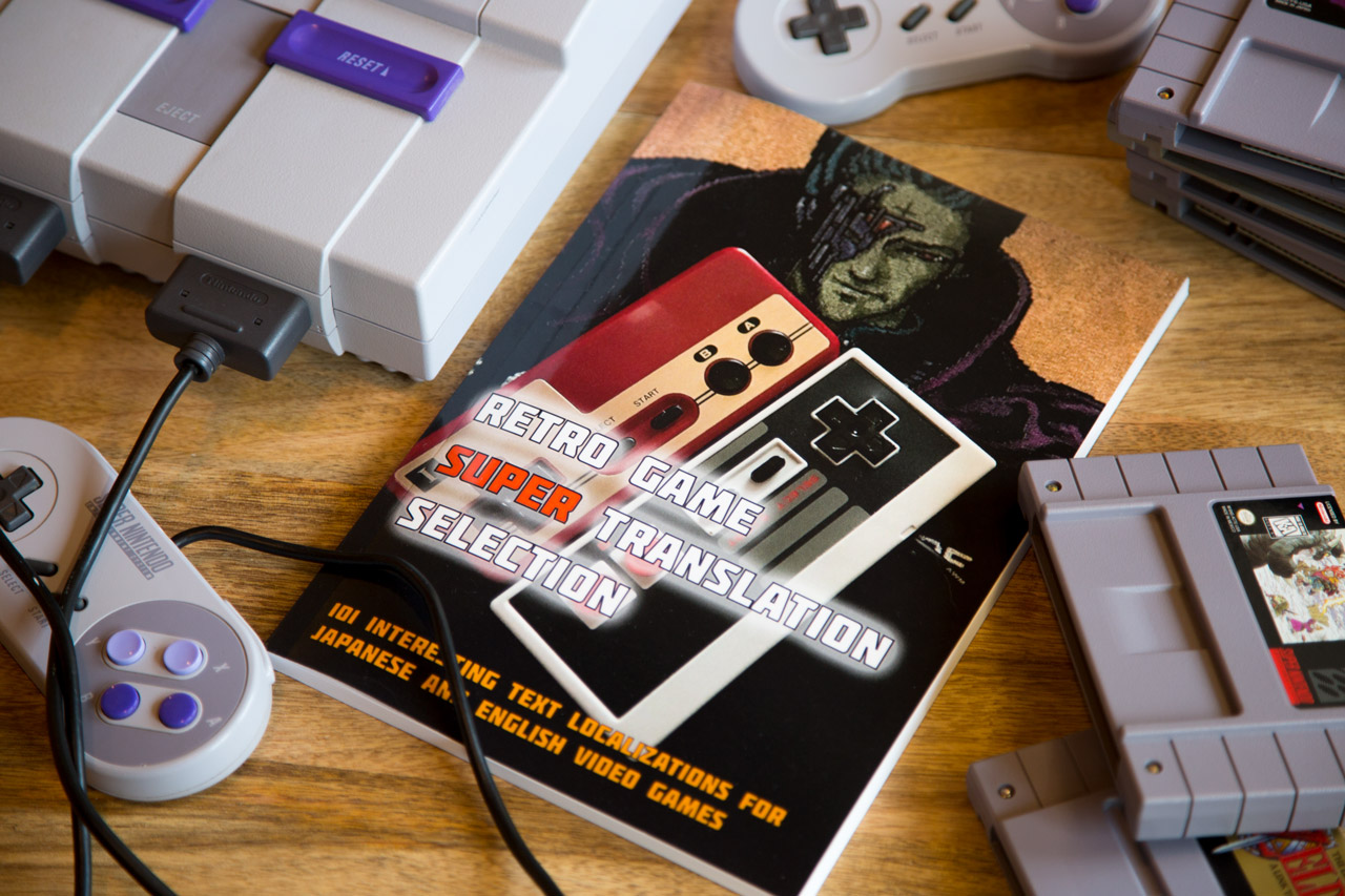 retro game super translation select book surrounded by SNES games