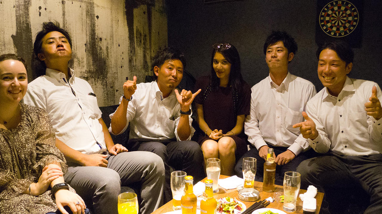 elodie and sonia with four salarymen