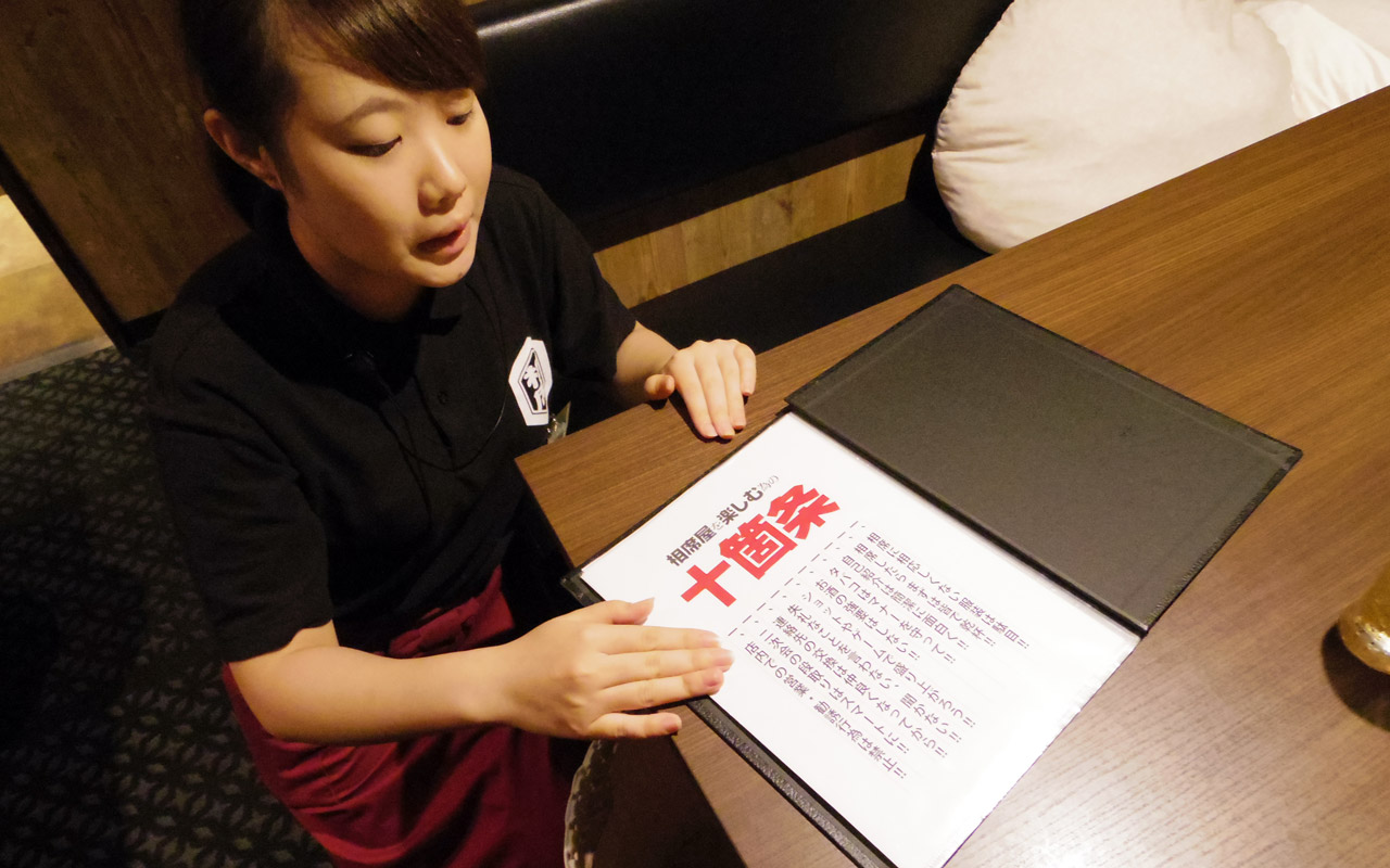 waitress at aisekiya explaining menu
