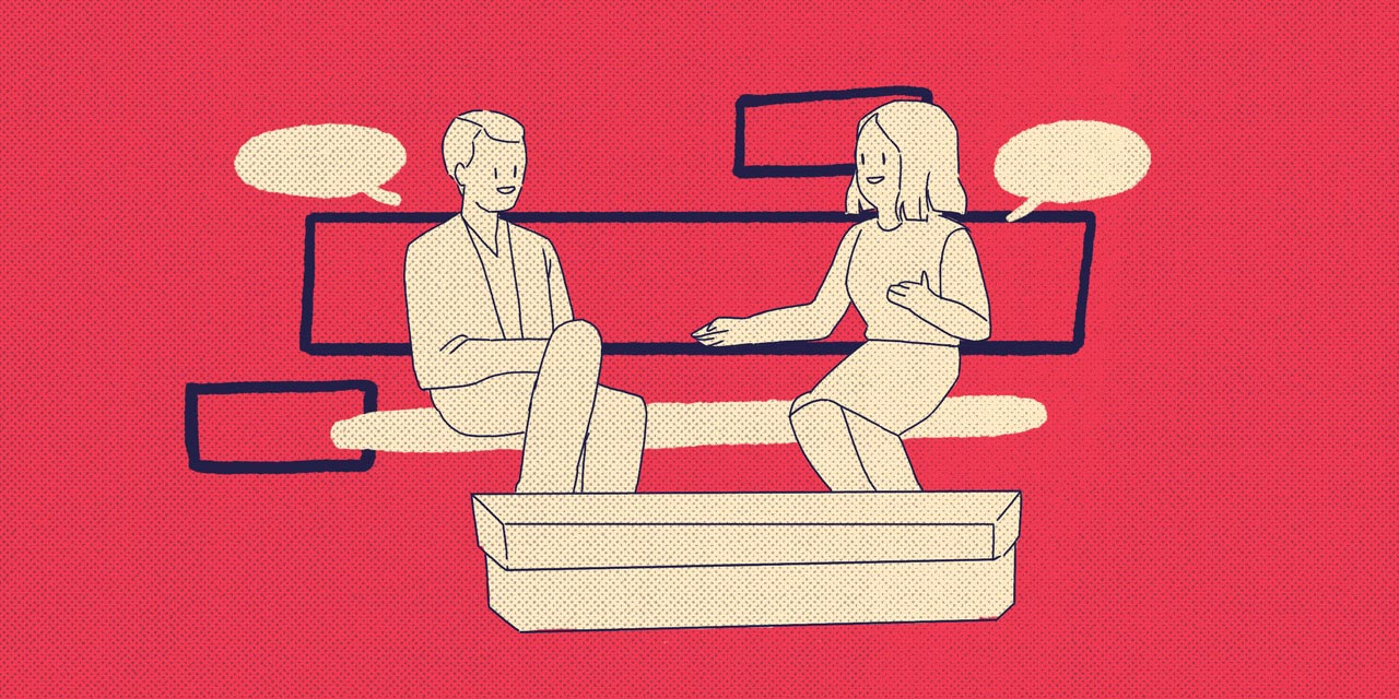 two people one a couch talking
