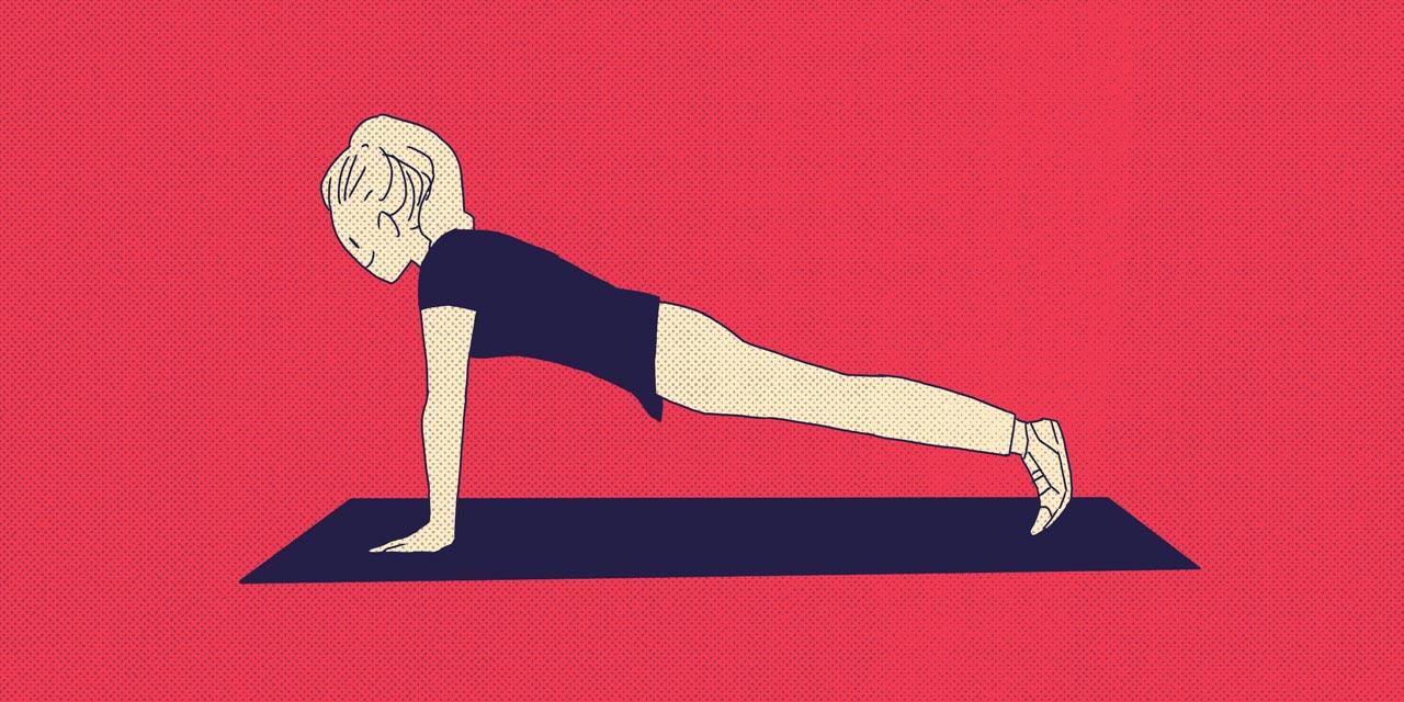 woman doing push ups on a mat