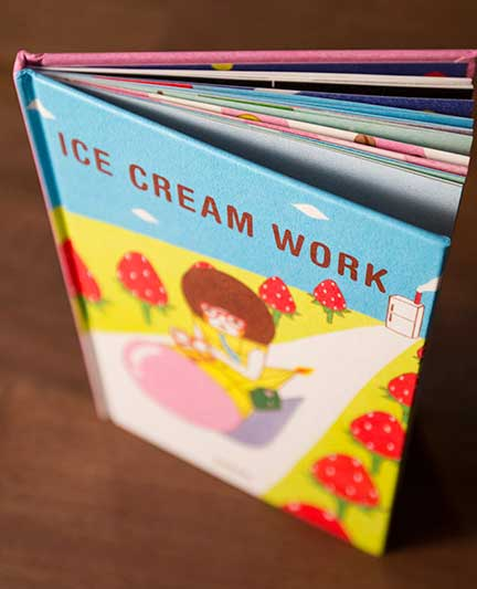 _Ice Cream Work_ by Naoshi standing upright on a desk