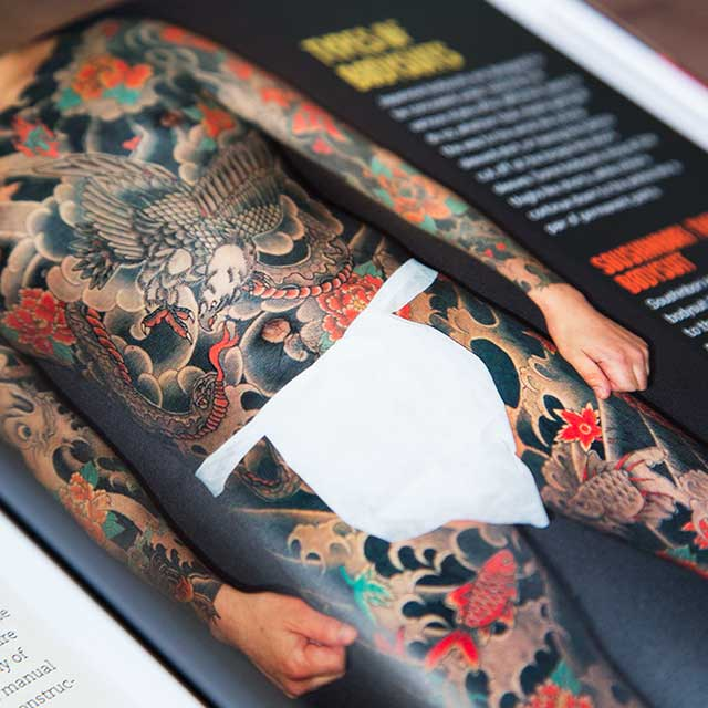 japanese tattoo bodysuit in a book