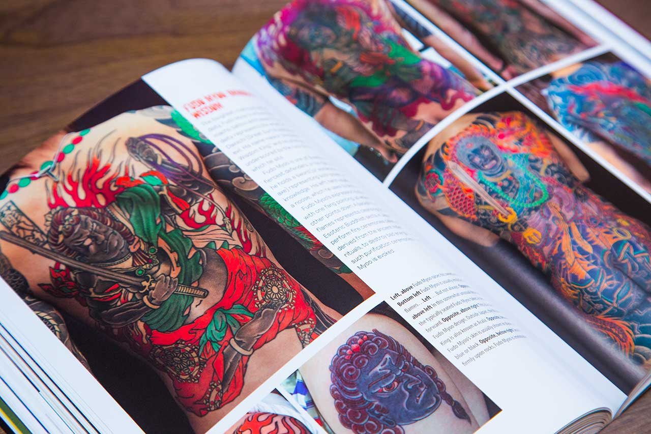 open book with pictures of irezumi