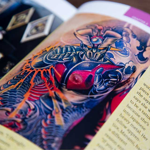 mazinger z tattoo in a book