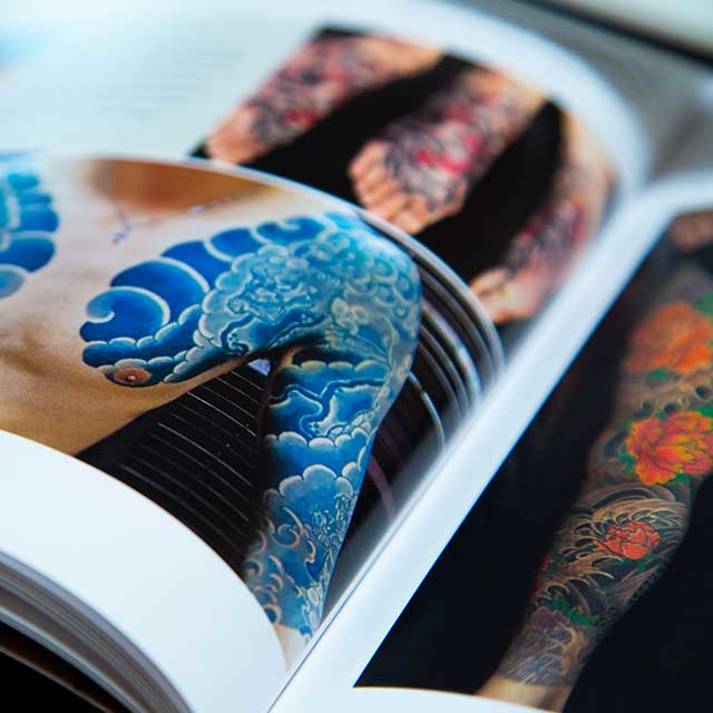 blue wave irezumi in a book