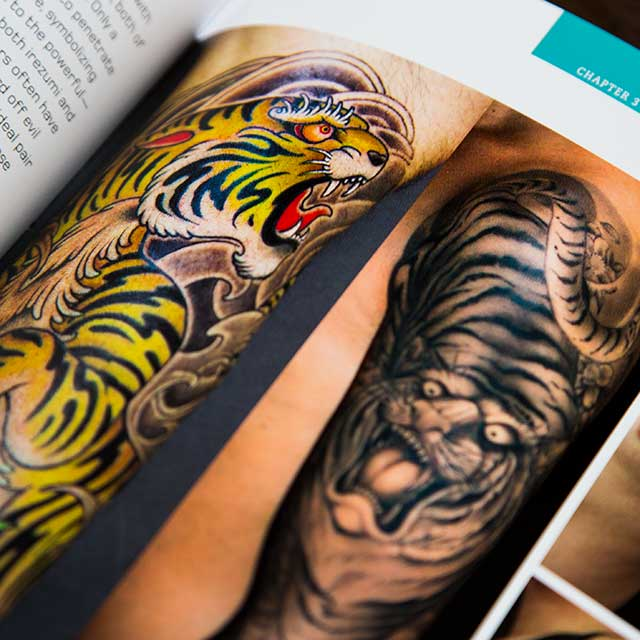 various tiger tattoos in a book