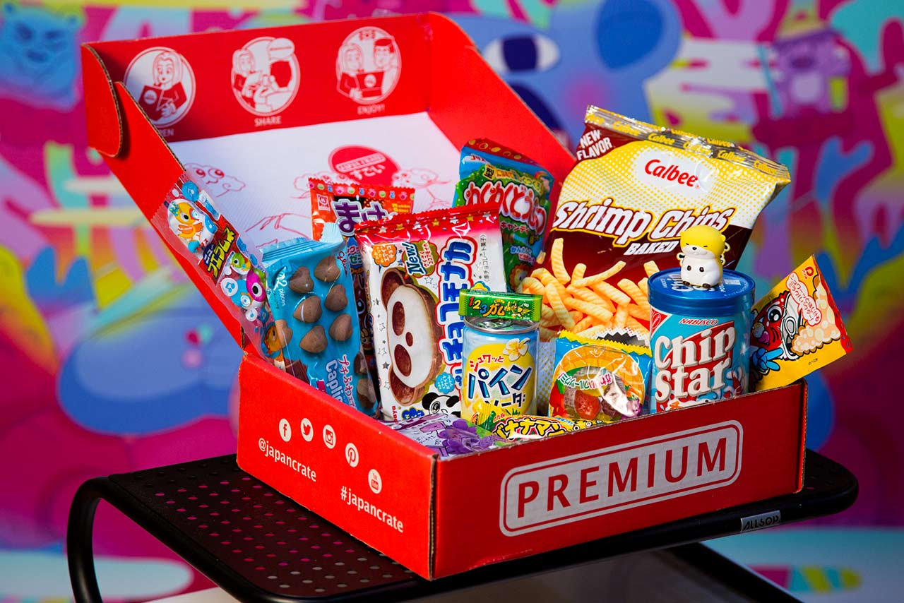 red subscription box displaying japanese snacks