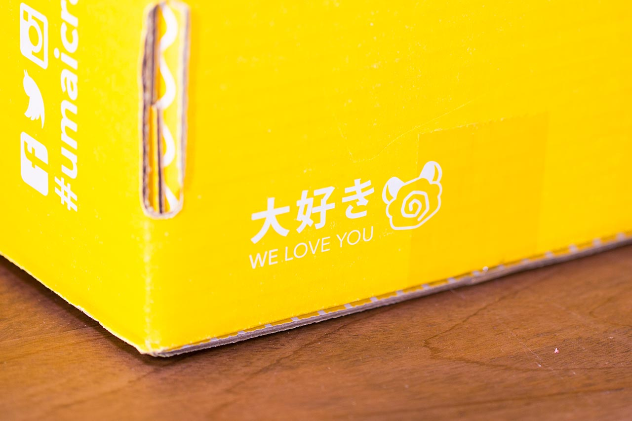 text on the side of umai crate that says i love you