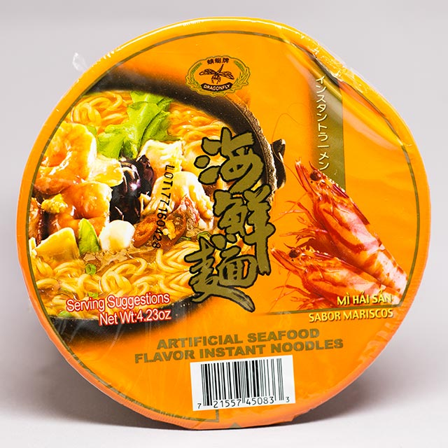 yellow package of instant ramen with a dent in the side
