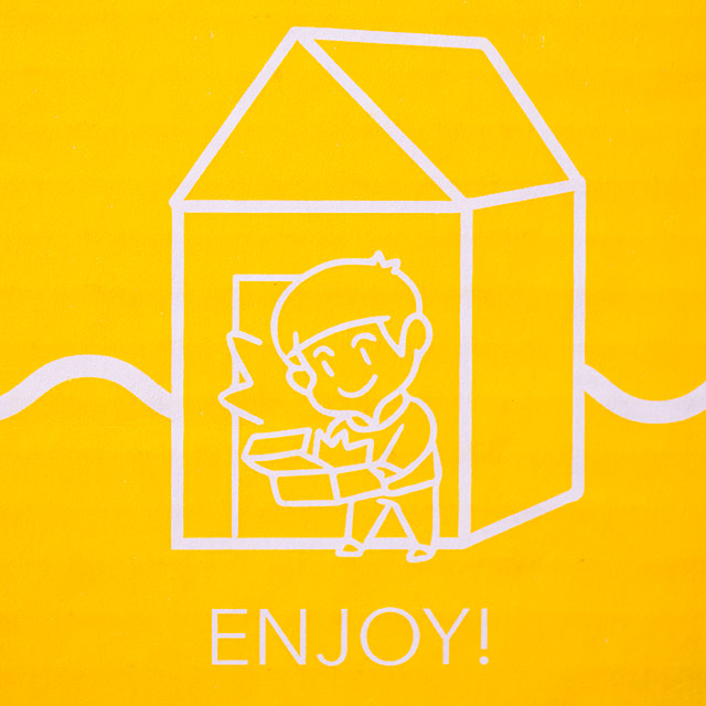 illustration on side of umai crate that says enjoy
