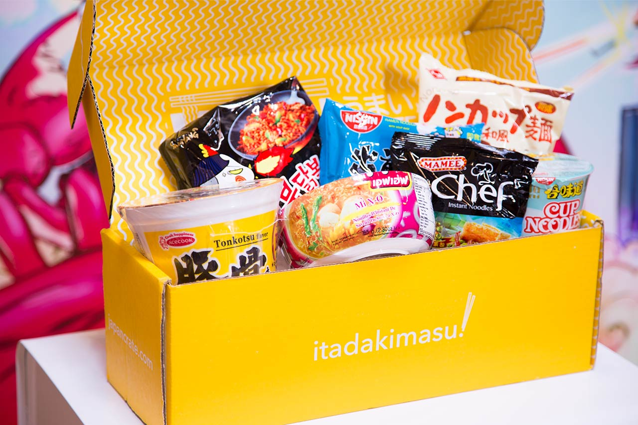 open umai crate box displaying packages of japanese instant noodles