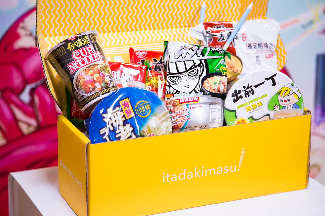 big yellow umai crate subscription box open showing instant noodles