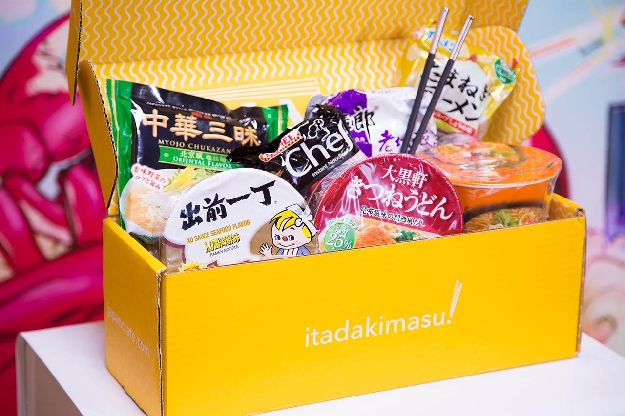 bright yellow cardboard box filled with instant noodle packages