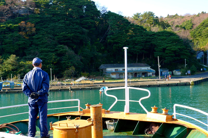 man looking toward tashirojima from boat
