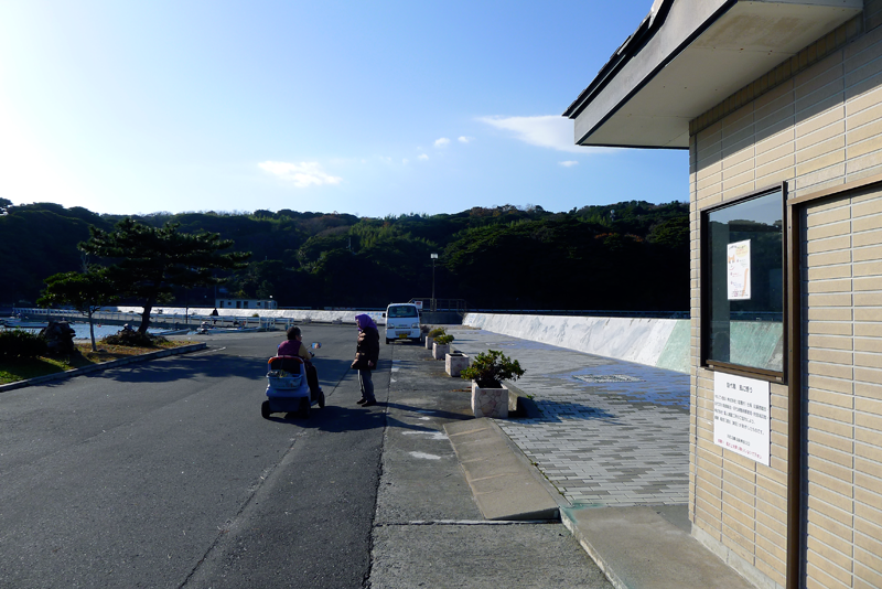 citizens of tashirjima waiting for the ferry