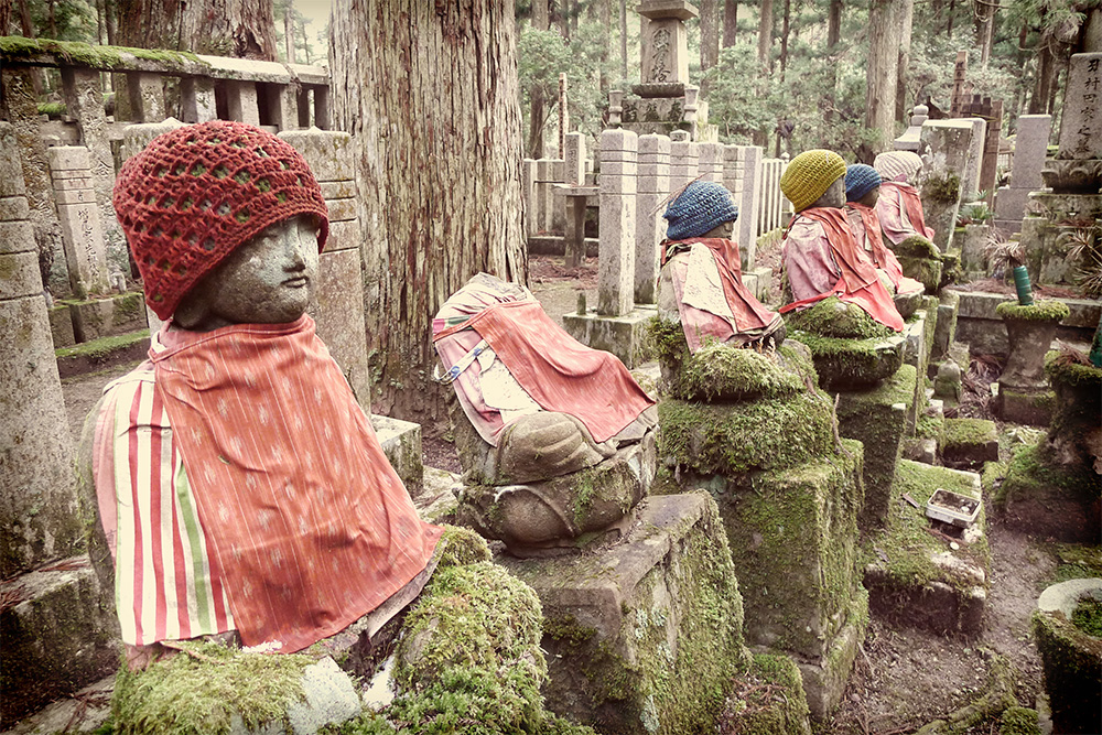 stone statues with knit caps