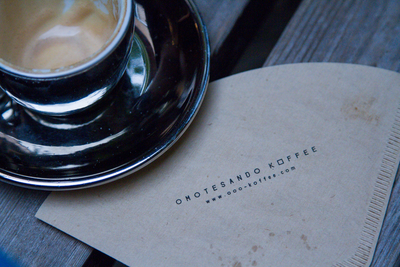 top view of coffee cup and napkin printed with omotesando koffee