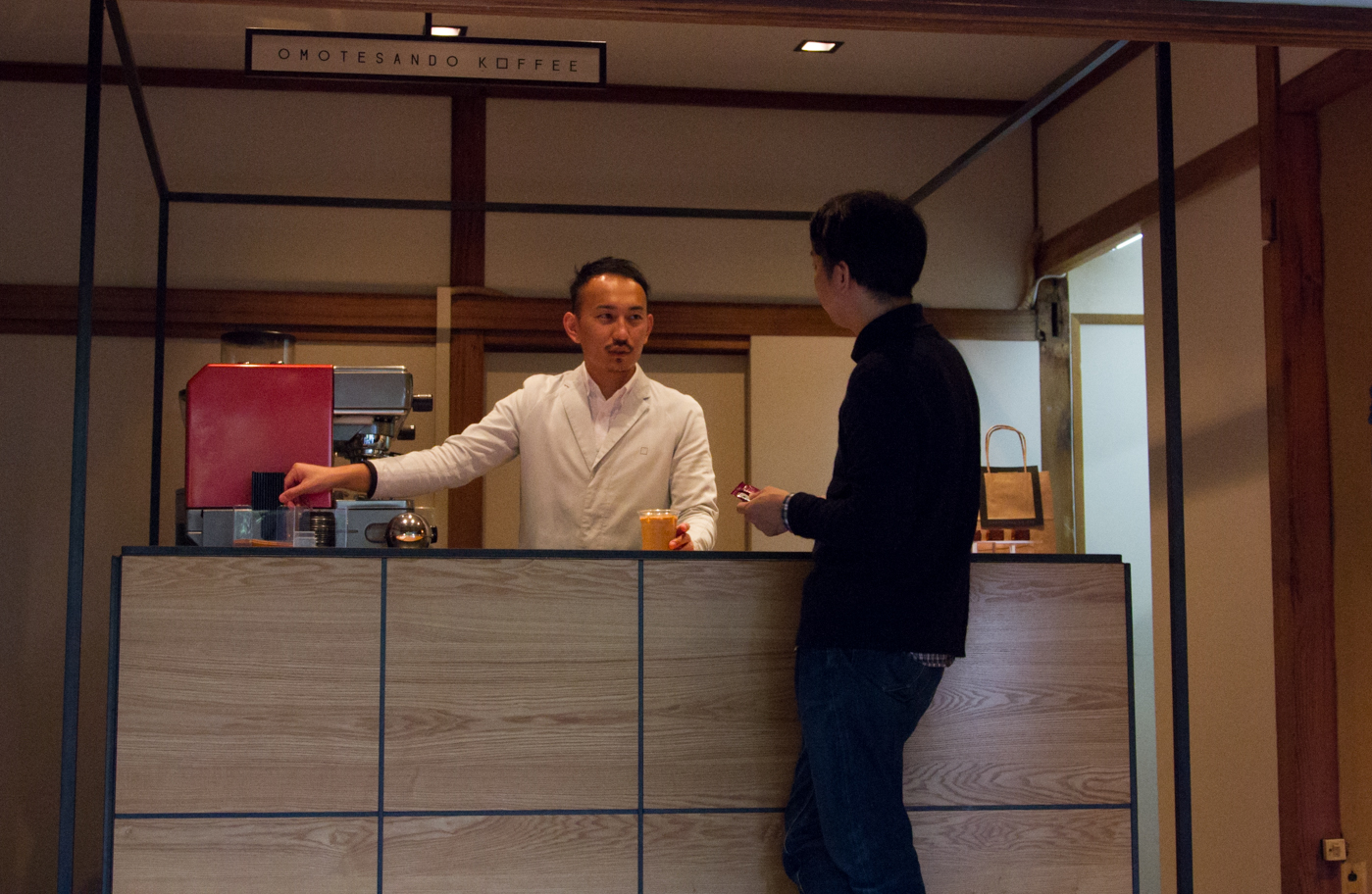 omotesando koffee counter where japanese barista is talking to customer